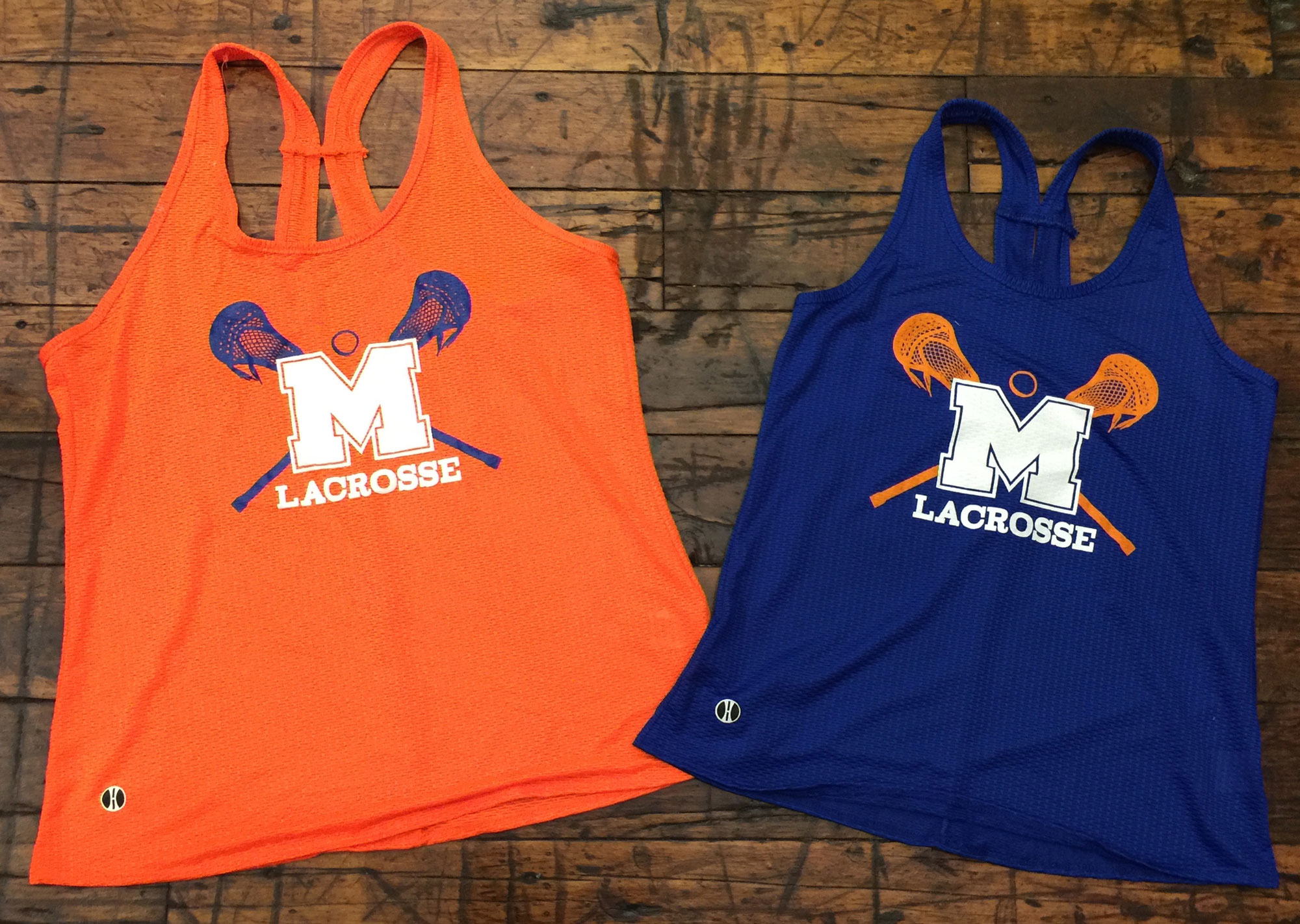 2 lacrosse tank tops with switched colors