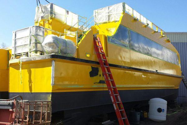 Early stages NYC Water Taxi Boat Wraps